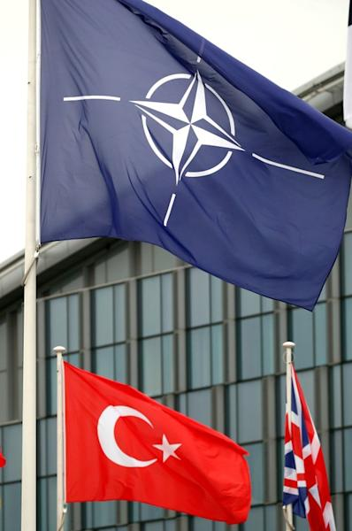 FILE PHOTO: NATO and Turkish flags flutter at the Alliance headquarters in Brussels