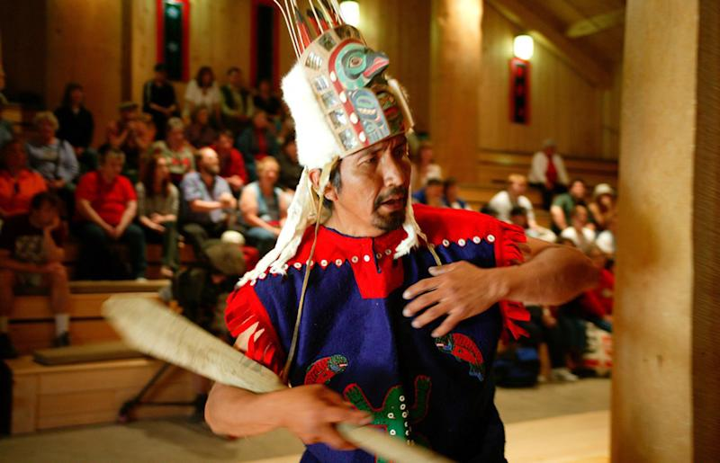FILE In this photo taken in May of 2005, a Tlingit dancer performs at the Native theater at Icy Strait Point in Hoonah Alaska. An Alaska Native village corporation that operates a popular cruise ship destination has launched a commercial consulting service for others seeking help developing their own cultural tourism ventures. Huna Totem Corp. opened Alaska Native Voices on Wednesday, May 1, 2013. Huna Totem is the village Native corporation for Hoonah, a largely Tlingit community of 775 in southeast Alaska and one of the front-runners of tribal tourism, a growing trend in Alaska and nationally. (AP Photo/Icy Strait Point) NO SALEs