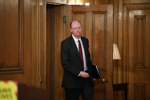 England's chief medical officer Professor Chris Whitty arrives for a media briefing in Downing Street