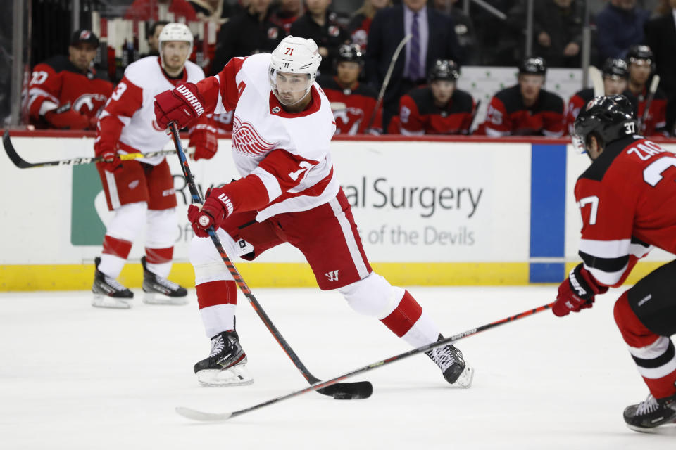 Detroit Red Wings center Dylan Larkin (71) shoots with New Jersey Devils center Pavel Zacha (37) trying to stop him during the first period of an NHL hockey game, Thursday, Feb. 13, 2020, in Newark, N.J. (AP Photo/Kathy Willens)