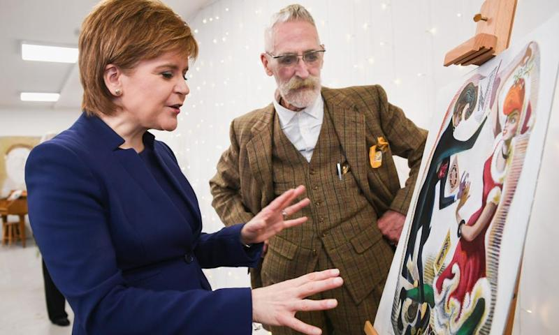 Scottish First Minister Nicola Sturgeon and John Byrne unveil the artwork for her official 2017 Christmas card at St Margaret's House on 5 December in Edinburgh.