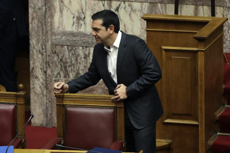 Greek Prime Minister Alexis Tsirpas arrives for a debate at the Greek Parliament in Athens, Monday, Nov. 27, 2017. A leading global rights watchdog is urging Greece's government to scrap a controversial arms sale to Saudi Arabia, saying the weapons could be used against civilians in the ongoing war in Yemen. (AP Photo/Thanassis Stavrakis)