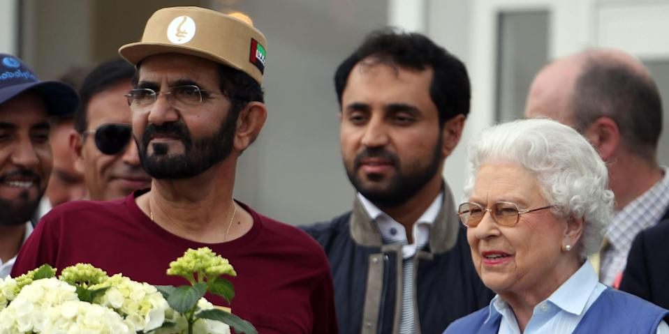 Queen Elizabeth II meets HH Sheikh Mohammed Bin Rashid Al Maktoum (left) at the finish of the Royal Windsor Endurance at the Royal Windsor Horse Show at Windsor Castle, London. (Photo by Steve Parsons/PA Images via Getty Images)