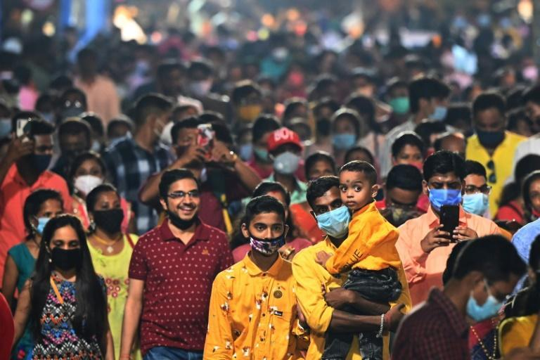 India's main religious festival season is back in full swing with huge noisy crowds thronging markets and fairs for the first time in two years (AFP/DIBYANGSHU SARKAR)