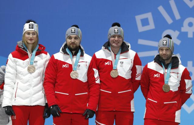 Medals Ceremony - Luge - Pyeongchang 2018 Winter Olympic Games - Team Relay - Medals Plaza - Pyeongchang, South Korea - February 16, 2018 - Bronze medalists Madeleine Egle, David Gleirscher, Peter Penz and Georg Fischler of Austria on the podium. REUTERS/Eric Gaillard