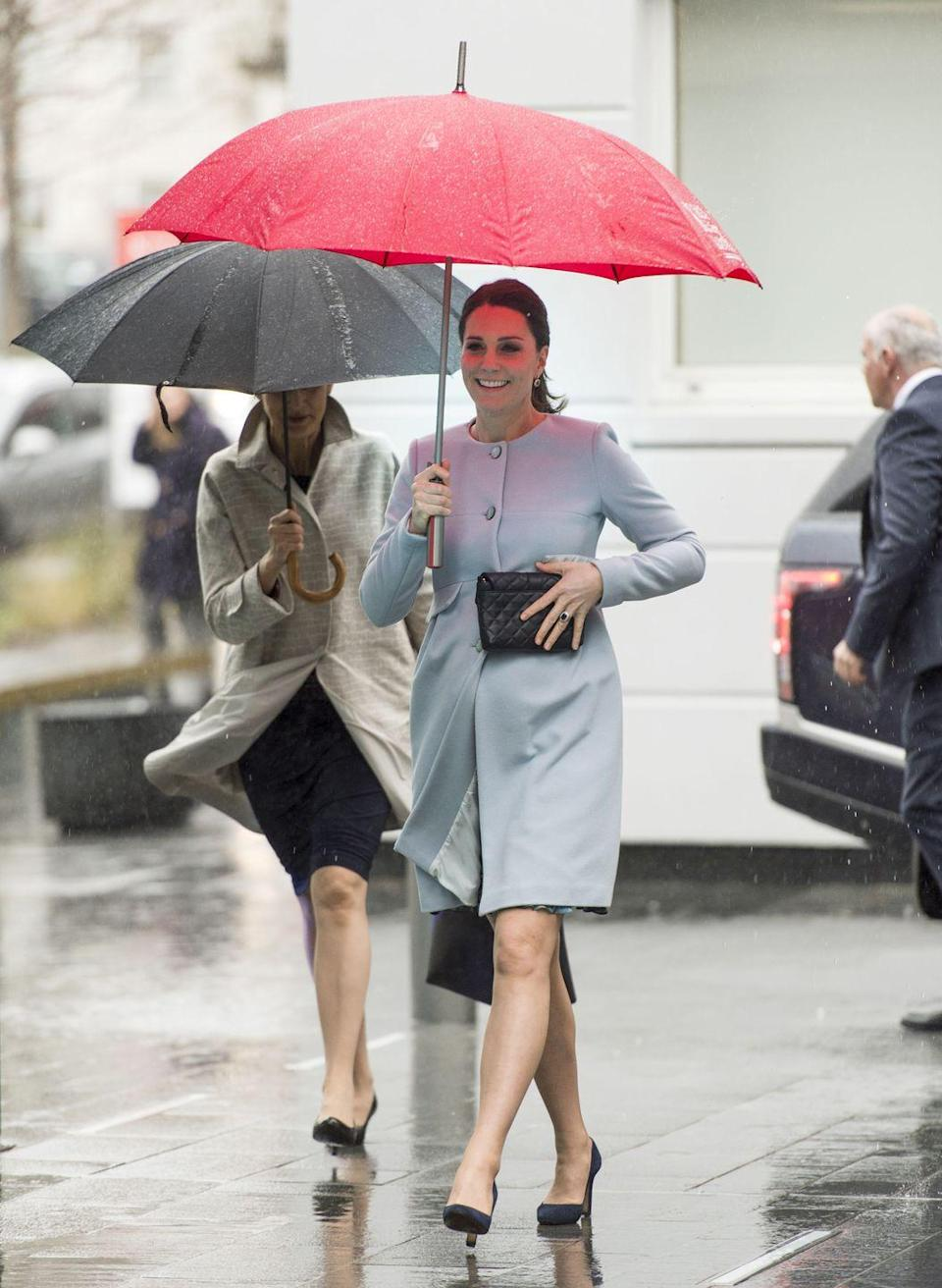 """<p>The Duchess stepped out on a rainy day in London in a pale blue cashmere blend coat <a href=""""https://go.redirectingat.com?id=74968X1596630&url=https%3A%2F%2Fwww.seraphine.com%2Fen-us%2Fnatasha-cashmere-blend-coat.html&sref=https%3A%2F%2Fwww.townandcountrymag.com%2Fstyle%2Ffashion-trends%2Fnews%2Fg1633%2Fkate-middleton-fashion%2F"""" rel=""""nofollow noopener"""" target=""""_blank"""" data-ylk=""""slk:by Seraphine, which is still on sale for $299."""" class=""""link rapid-noclick-resp"""">by Seraphine, which is still on sale for $299.</a> She accessorized with a black clutch and black heels.</p>"""