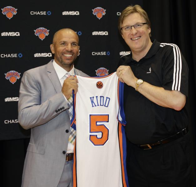 New York Knicks executive vice president and general manager Glen Grunwald poses for a photograph with Jason Kidd, one of the Knicks two newest additions, following a news conference at the team's training facility in Tarrytown, N.Y., Thursday, July 12, 2012. (AP Photo/Kathy Willens)