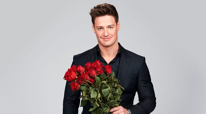 Matt Agnew poses with a bunch of roses ahead of The Bachelor Australia premiere