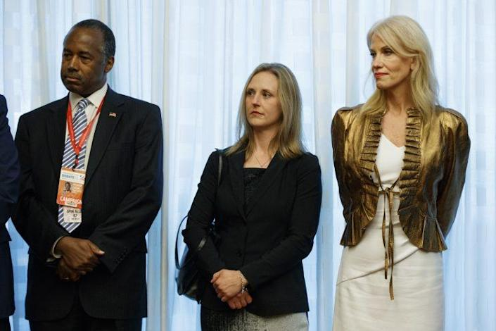 Candice Jackson, of the Dept. of Education, center, stands with Kellyanne Conway, campaign manager for republican presidential candidate Donald Trump, right, and Ben Carson, left, as they look on during a meeting between Trump, Paula Jones, Kathy Shelton, Juanita Broaddrick, and Kathleen Willey, before the second presidential debate with democratic presidential candidate Hillary Clinton at Washington University, Sunday, Oct. 9, 2016, in St. Louis.