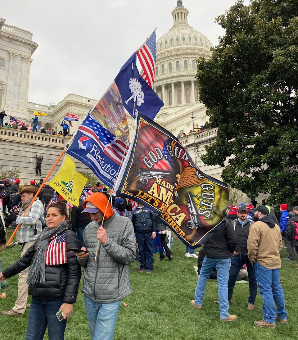 People hold flags glorifying violence and religion near the U.S. Capitol, which was breached on Jan. 6 by thousands of rioters who rejected the results of the 2020 presidential election. (Photo: zz/STRF/STAR MAX/IPx)
