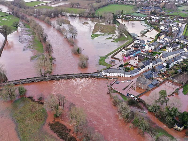 An aerial view of the Welsh village of Crickhowell which has been cut off as the river Usk bursts its banks at Crickhowell bridge near the Bridge End Inn: Getty Images