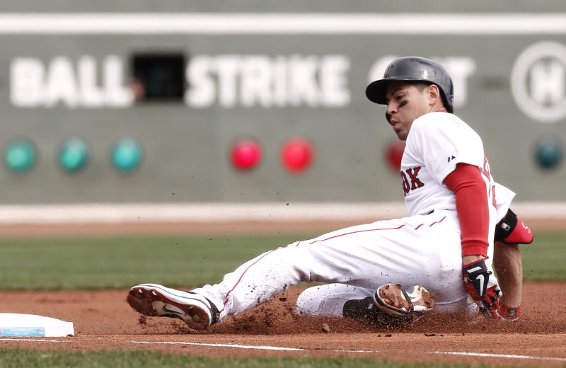 Boston Red Sox's Jacoby Ellsbury slides in safely with a triple during the first inning of a baseball game against the Tampa Bay Rays at Fenway Park in Boston Monday, April 15, 2013. (AP Photo/Winslow Townson)