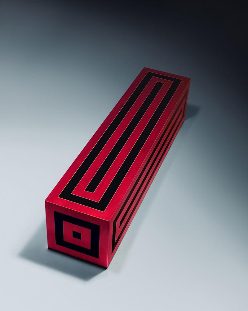 A sculptural red and black bench featured in Jonathan Saunders' debut furniture collection.