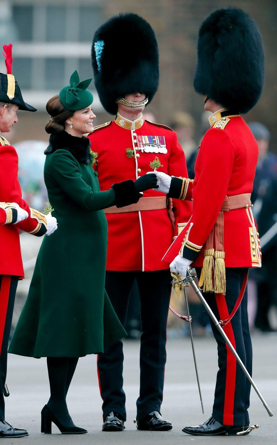 """<p>In 2016, Kate made the decision not to present the shamrocks to the 1st battalion Irish Guards on St. Patricks Day—<a href=""""https://www.vox.com/2015/3/17/8227727/shamrock-boer-war"""" rel=""""nofollow noopener"""" target=""""_blank"""" data-ylk=""""slk:a tradition"""" class=""""link rapid-noclick-resp"""">a tradition</a> first started by Queen Victoria to support the Irish in the Boer War. Kate was <a href=""""https://www.express.co.uk/news/royal/654056/Duchess-of-Cambridge-Kate-Middleton-work-shy-blasted-Kensignton-Palace"""" rel=""""nofollow noopener"""" target=""""_blank"""" data-ylk=""""slk:ridiculed on social media"""" class=""""link rapid-noclick-resp"""">ridiculed on social media</a> for staying home with her children while Prince William attended.</p><p>Kensington Palace released the following statement: """"While the Duchess has accompanied the Duke every year since his appointment in 2012, and will do so again in future, this year she sadly could not make it because she is prioritising time with her children before next month's tour of India and Bhutan.""""</p><p>This February, Kate chose to attend and present the shamrocks (pictured).</p>"""