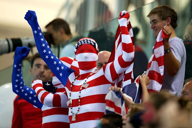 LONDON, ENGLAND - JULY 31: United States fans cheer on their swimmers on Day 4 of the London 2012 Olympic Games at the Aquatics Centre on July 31, 2012 in London, England. (Photo by Clive Rose/Getty Images)