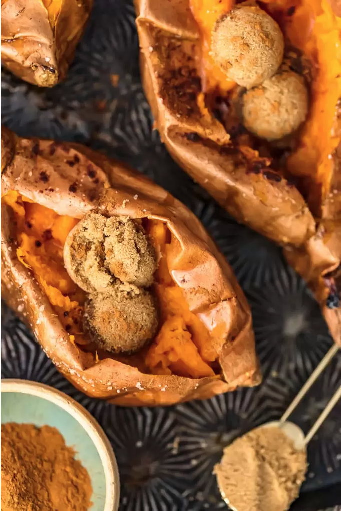 """<p>Although this recipe is super simple, it's ridiculously delicious. You can't go wrong with a heaping of butter, cinnamon, and sugar!</p><p><strong>Get the recipe at <a href=""""https://www.thecookierookie.com/perfect-baked-sweet-potato/"""" rel=""""nofollow noopener"""" target=""""_blank"""" data-ylk=""""slk:The Cookie Rookie"""" class=""""link rapid-noclick-resp"""">The Cookie Rookie</a>.</strong> </p>"""