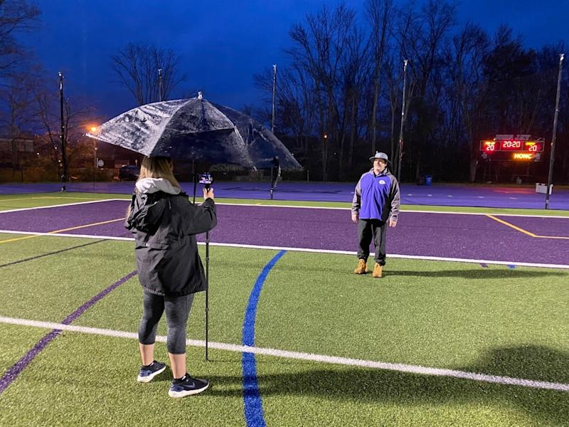 Chris McCarthy, director of health, physical education, athletics and wellness at the Katonah-Lewisboro School District recording a video.