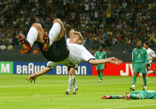 FILE - In this file photo from June 1, 2002, Germany's Miroslav Klose performs a somersault after scoring his second goal during the 2002 World Cup Group E soccer match between Germany and Saudi Arabia at the Sapporo Dome in Japan. The other teams in Group E are Ireland and Cameroon. Germany beat Saudi Arabia 8-0. (AP Photo/Christof Stache, File)