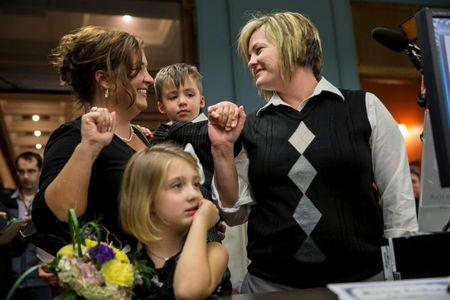 Kelley Harris (L) and her partner of 13 years, Kelly Barnard, apply for a marriage license with their son, Cooper Harris, and daughter, Mackenzie Harris, at City Hall in St. Louis, Missouri November 5, 2014.  REUTERS/Whitney Curtis
