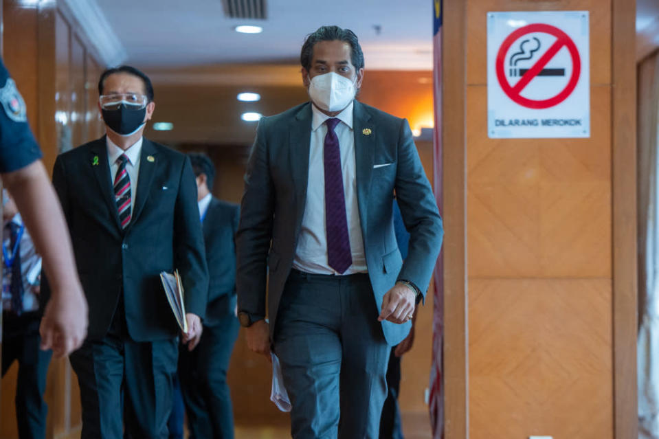 Health Minister Khairy Jamaluddin on his way to a press conference in Putrajaya, September 1, 2021. — Picture by Shafwan Zaidon