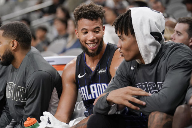 Orlando Magic's Michael Carter-Williams, left, and Markelle Fultz talk on the bench during the second half of an NBA preseason basketball game against the San Antonio Spurs, Saturday, Oct. 5, 2019, in San Antonio. (AP Photo/Darren Abate)