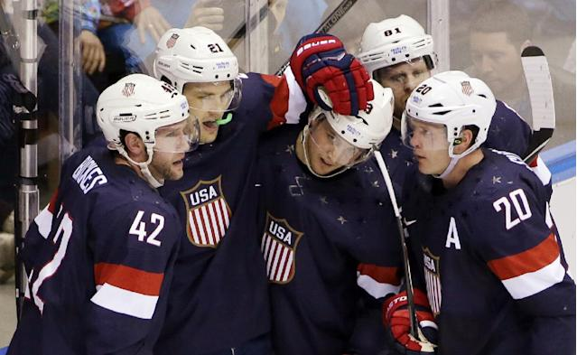 Team USA celebrates a second period goal against Russia during a men's ice hockey game at the 2014 Winter Olympics, Saturday, Feb. 15, 2014, in Sochi, Russia