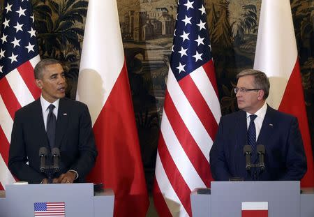 U.S. President Barack Obama addresses during a joint press conference with Poland's President Bronislaw Komorowski (R) at Belveder Palace in Warsaw June 3, 2014. Obama said on Tuesday he had come to Poland to affirm U.S. commitment to its security and called on the U.S. Congress to support up to $1 billion in funding to reassure eastern European allies about Washington's support. REUTERS/Kuba Atys/Agencja Gazeta