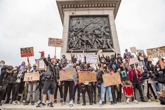 Young protesters seen at Trafalgar Square with Black Lives Matters placards during the demonstration. (PA)