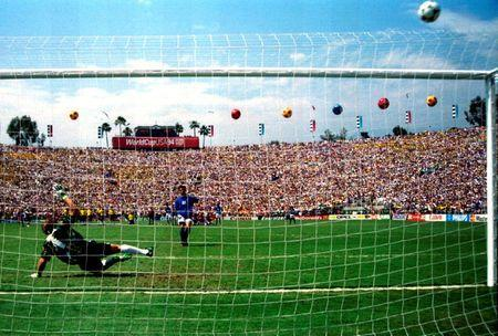 FILE PHOTO: Italy's Roberto Baggio puts his penalty over the bar in the World Cup final against Brazil at the Rose Bowl in Pasadena, California July 17, 1994. REUTERS/Gary Hershorn/File Photo