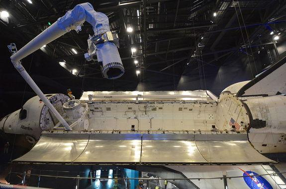 With its payload bay open, Canadarm robotic arm deployed and window covers removed, space shuttle Atlantis is ready for its public debut on June 29, 2013 at NASA's Kennedy Space Center Visitor Complex in Florida.