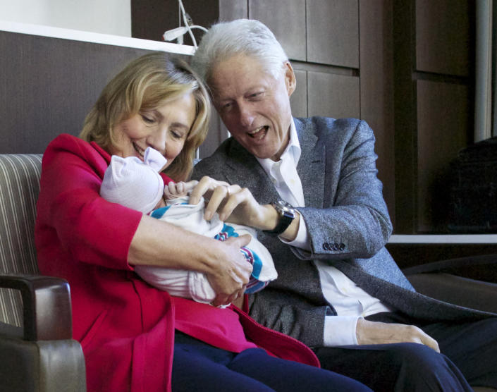 <p>Former Secretary of State Hillary Rodham Clinton and former President Bill Clinton with their granddaughter, Charlotte Clinton Mezvinsky, on Sept. 27, 2014, at Lenox Hill Hospital in New York. (Photo: Office of President Clinton, Jon Davidson/AP)</p>