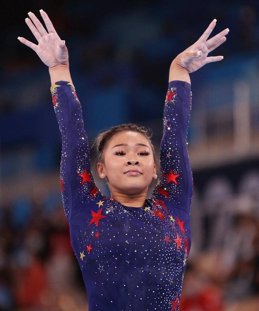 TOKYO, JAPAN – JULY 25: Sunisa Lee of Team United States reacts after competing on balance beam during Women's Qualification on day two of the Tokyo 2020 Olympic Games at Ariake Gymnastics Centre on July 25, 2021 in Tokyo, Japan. (Photo by Ezra Shaw/Getty Images)
