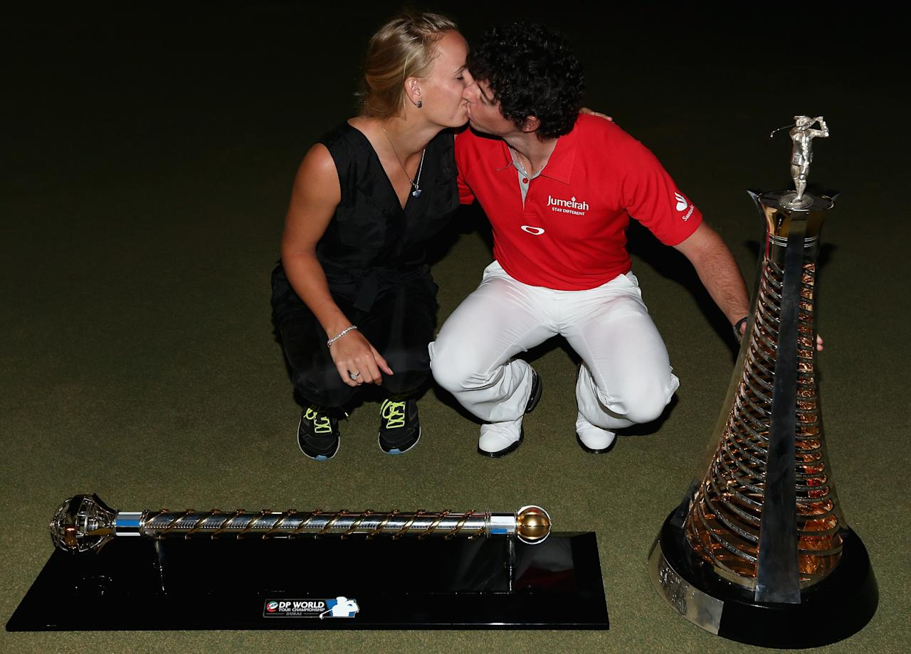 DUBAI, UNITED ARAB EMIRATES - NOVEMBER 25:  Rory McIlroy of Northern Ireland poses alongside his girlfriend Caroline Wozniacki with both the Race To Dubai and DP World Tour Championship trophies after winning the DP World Tour Championship on the Earth Course at Jumeirah Golf Estates on November 25, 2012 in Dubai, United Arab Emirates.  (Photo by Andrew Redington/Getty Images)