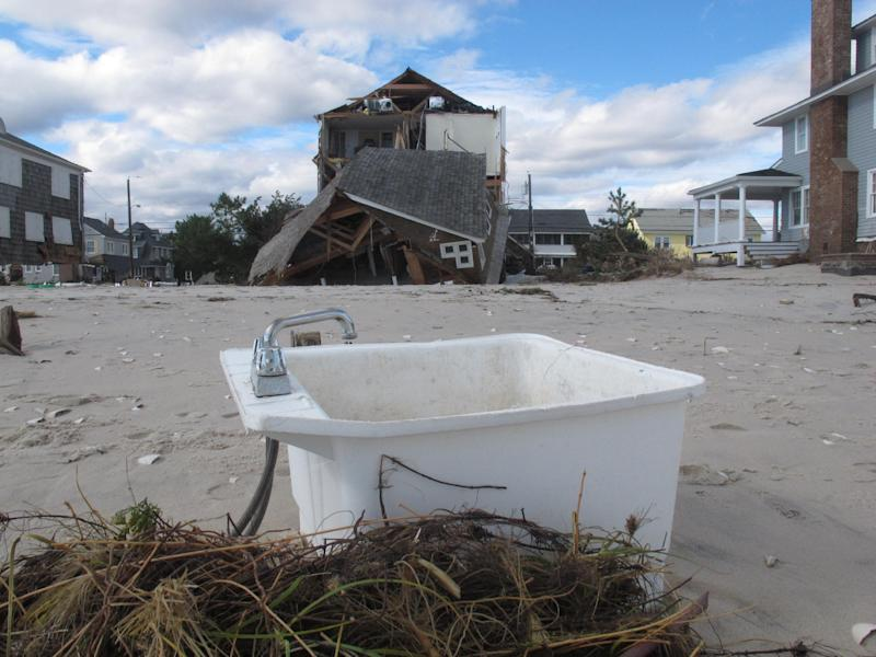 in an Oct. 31, 2012, photo a kitchen sink sits on the beach in Mantoloking, N.J., two days after Superstorm Sandy devastated the Jersey shore town. Even with federal reimbursement for much of the cleanup and rebuilding expenses, hard-hit towns could be facing property tax hikes next year as a result of the unexpected costs, and the loss of millions of dollars of taxable property. (AP Photo/Wayne Parry)