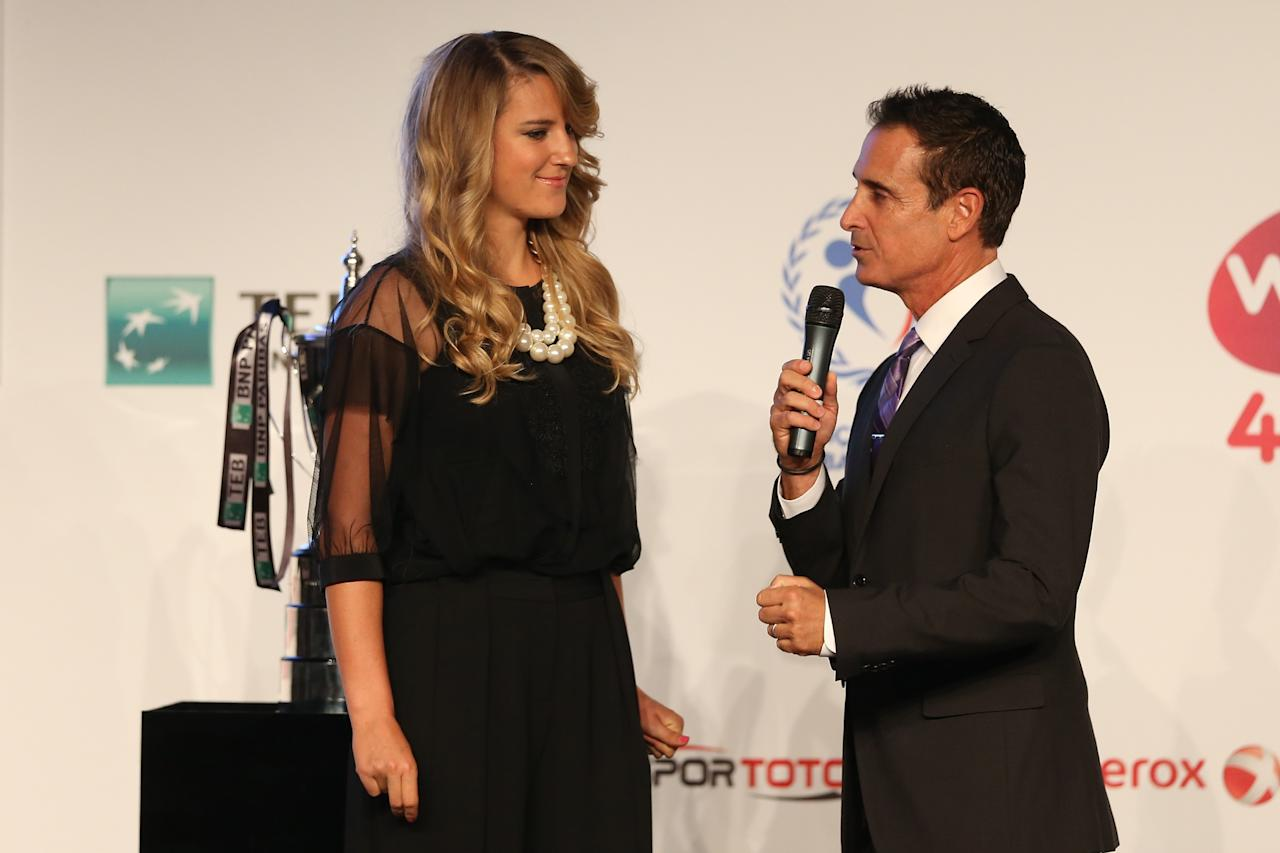 ISTANBUL, TURKEY - OCTOBER 20: Victoria Azarenka of Belarus is interviewed by Master of Ceremonies Andrew Krasny during the draw ceremony for the WTA Championships at the Renaissance Polat Hotel on October 20, 2013 in Istanbul, Turkey. (Photo by Matthew Stockman/Getty Images)