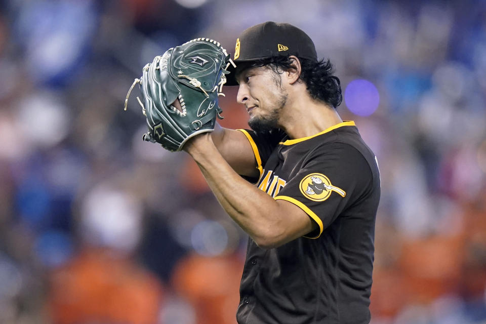 San Diego Padres starting pitcher Yu Darvish reacts after giving up two runs to the Miami Marlins during the fifth inning of a baseball game, Sunday, July 25, 2021, in Miami. (AP Photo/Lynne Sladky)