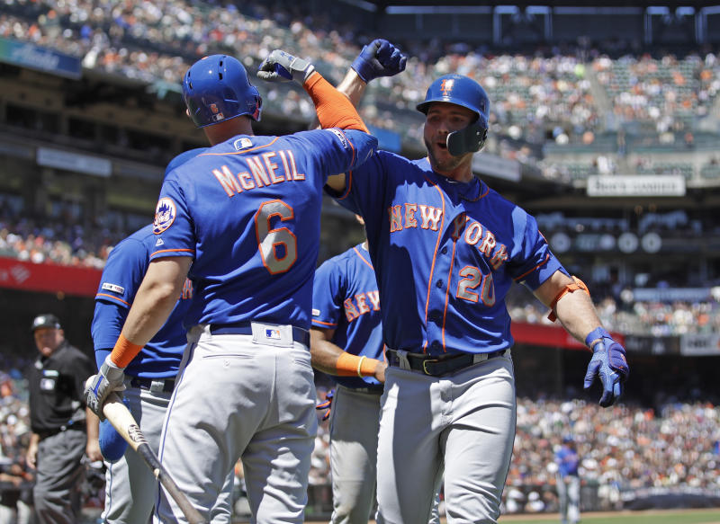 New York Mets' Pete Alonso, right, celebrates with Jeff McNeil (6) after hitting a three-run home run off San Francisco Giants' Derek Holland in the sixth inning of a baseball game Saturday, July 20, 2019, in San Francisco. (AP Photo/Ben Margot)
