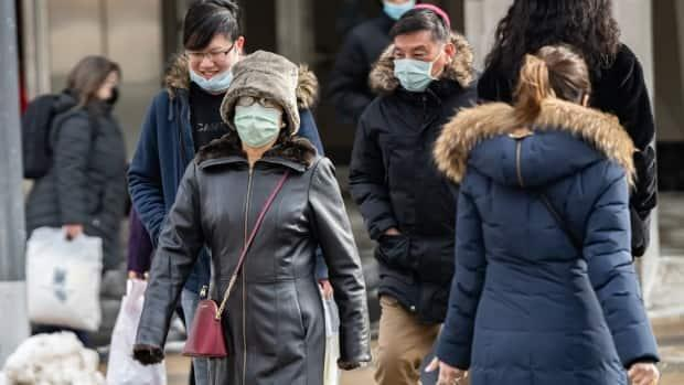 Pedestrians make their way through downtown Ottawa on Feb. 18, 2021, just days after the stay-at-home order was lifted and the city entered the orange zone. (Brian Morris/CBC - image credit)