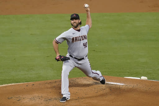 Arizona Diamondbacks starting pitcher Madison Bumgarner throws during the first inning of the team's baseball game against the Los Angeles Angels on Tuesday, Sept. 15, 2020, in Anaheim, Calif. (AP Photo/Ashley Landis)