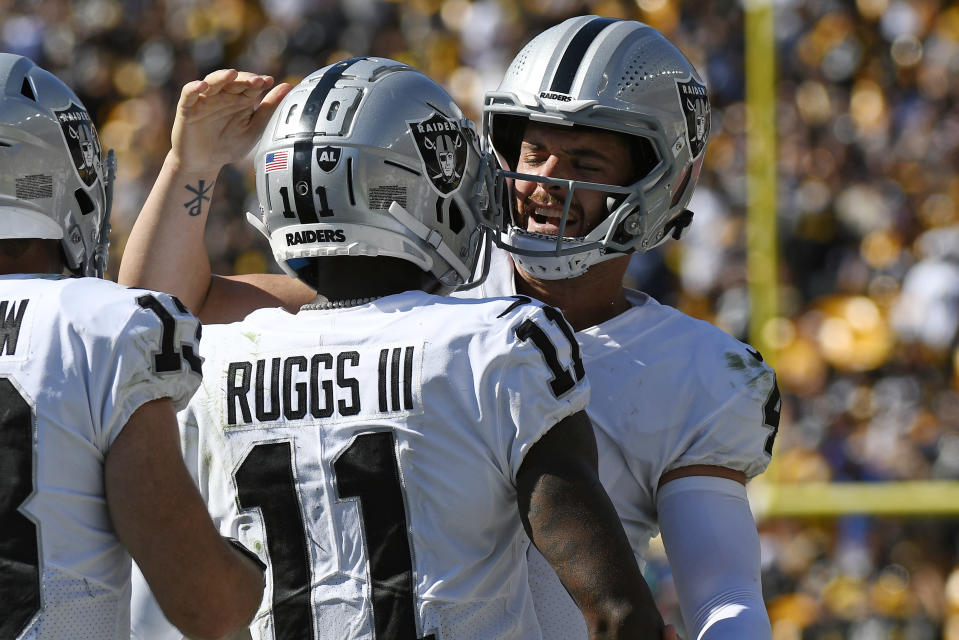 Las Vegas Raiders quarterback Derek Carr, right, celebrates a touchdown wide receiver Henry Ruggs III (11) during the second half of an NFL football game against the Pittsburgh Steelers in Pittsburgh, Sunday, Sept. 19, 2021. (AP Photo/Don Wright)