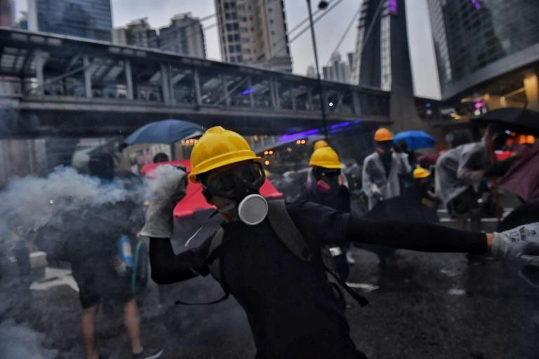 The financial hub has been gripped by street demonstrations for the past three months (AFP Photo/Lillian SUWANRUMPHA)