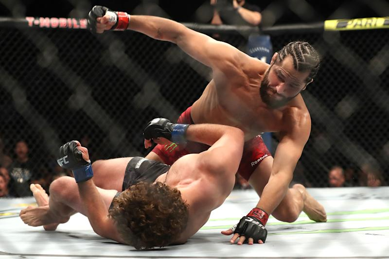 LAS VEGAS, NEVADA - JULY 06: Jorge Masvidal of the United States punches Ben Askren of the United States during their UFC 239 Welterweight Bout at T-Mobile Arena on July 06, 2019 in Las Vegas, Nevada. (Photo by Sean M. Haffey/Getty Images)