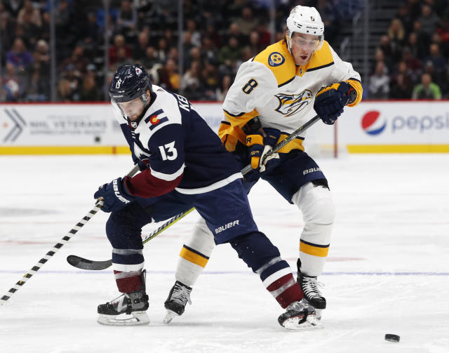 Colorado Avalanche center Alexander Kerfoot, left, and Nashville Predators center Kyle Turris vie for the puck during the second period of an NHL hockey game Wednesday, Nov. 7, 2018, in Denver. (AP Photo/David Zalubowski)