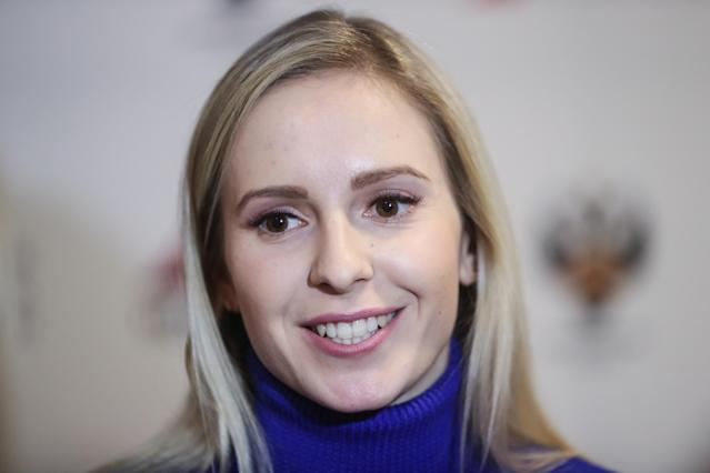 <p>Galina Arsenkina of the Russian national curling team, leaving for the 2018 Winter Olympic Games, attends a departure ceremony at the Pioner cinema. Sergei Savostyanov/TASS (Getty) </p>