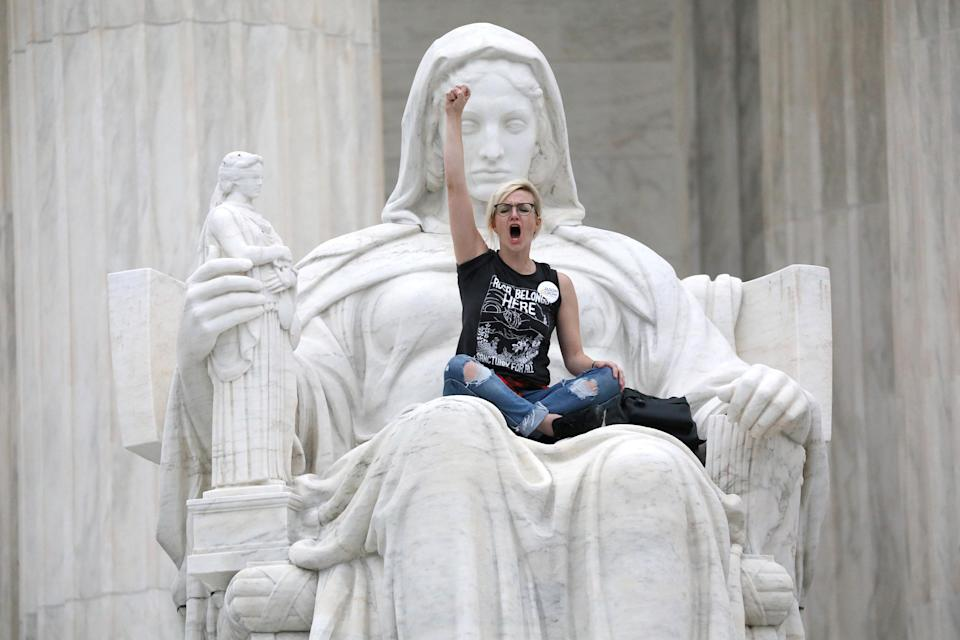 "<p>A protester sits on the lap of ""Lady Justice"" on the steps of the U.S. Supreme Court building as demonstrators storm the steps and doors of the Supreme Court while Judge Brett Kavanaugh is being sworn in as an Associate Justice of the court inside on Capitol Hill in Washington, D.C., Oct. 6, 2018. (Photo: Jonathan Ernst/Reuters) </p>"