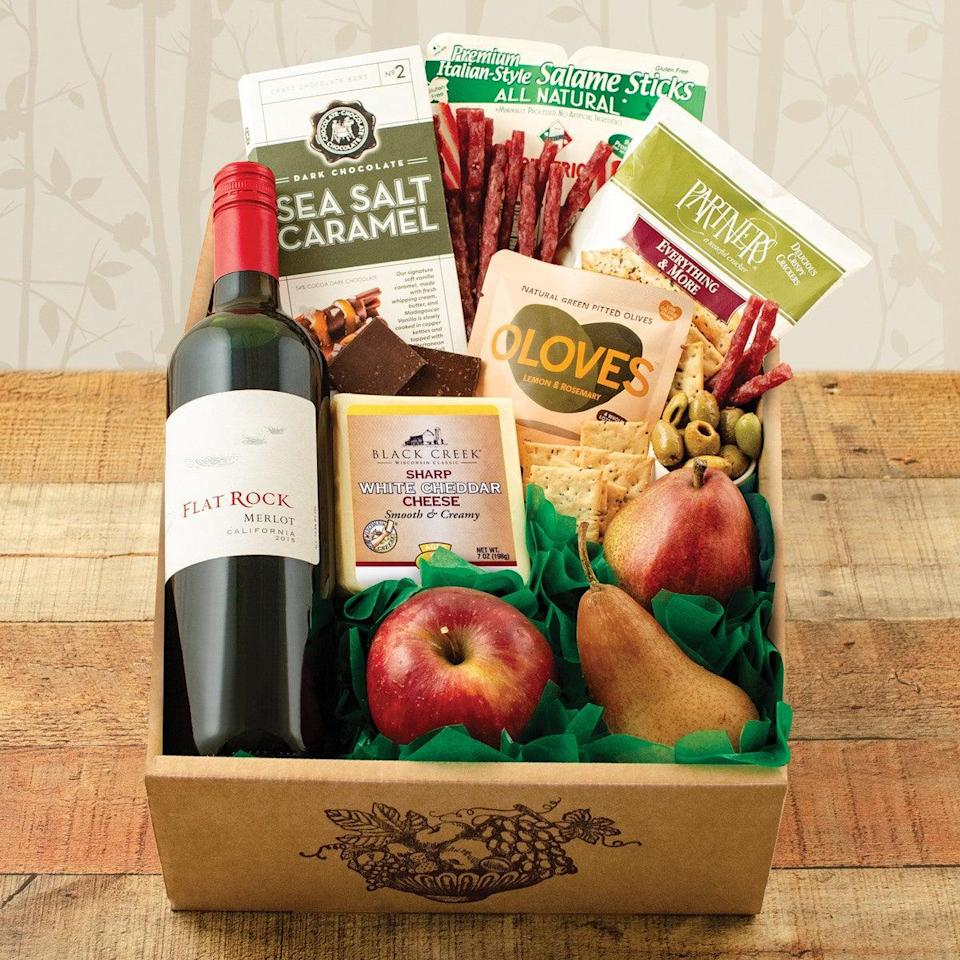 """<h2>Fruit, Cheese & Flat Rock Merlot Wine Gift Box</h2><br>If your mom is into snacking varietals, this gift box packed with everything from farm-fresh fruit to premium salame sticks and other yummy things (plus the wine, of course) will more than do the surprise-gifting trick. <br><br><em>Shop </em><strong><em><a href=""""https://www.winebasket.com/"""" rel=""""nofollow noopener"""" target=""""_blank"""" data-ylk=""""slk:Winebasket.com"""" class=""""link rapid-noclick-resp"""">Winebasket.com</a></em></strong><br><br><strong>Multiple Brands</strong> Fruit, Cheese & Flat Rock Merlot Wine Gift Box, $, available at <a href=""""https://go.skimresources.com/?id=30283X879131&url=https%3A%2F%2Fwww.winebasket.com%2FFruit-Cheese-Flat-Rock-Merlot-Wine-Gift-Box"""" rel=""""nofollow noopener"""" target=""""_blank"""" data-ylk=""""slk:Wine Basket"""" class=""""link rapid-noclick-resp"""">Wine Basket</a>"""