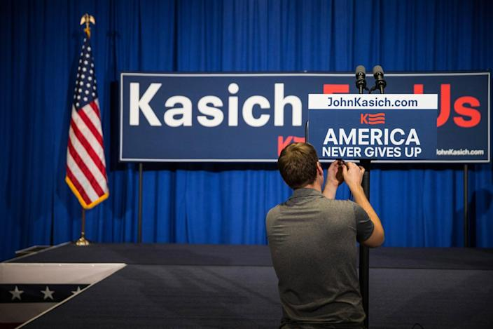 <p>A member of Gov. John Kasich's campaign prepares the room for the candidate's primary-night gathering in Concord, N.H. (Andrew Burton/Getty Images)</p>