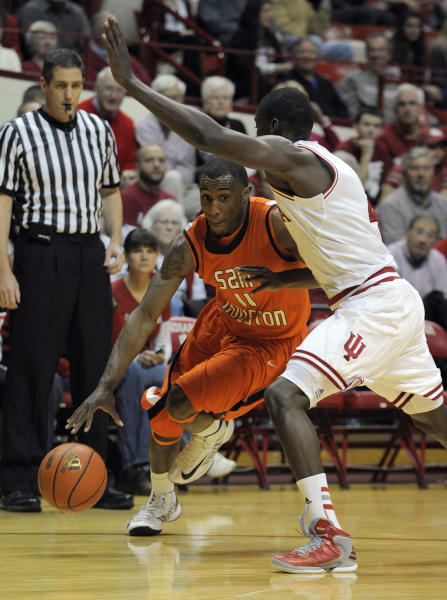 Sam Houston State guard Demarcus Gatlin, left, drives against Indiana guard Victor Oladipo during the first half of an NCAA college basketball game in Bloomington, Ind., Thursday, Nov. 15 2012. (AP Photo/Alan Petersime)