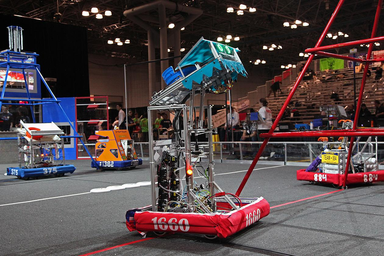 Two teams of robots completing on a 27 x 54 Foot field in the first round of elimination matches.