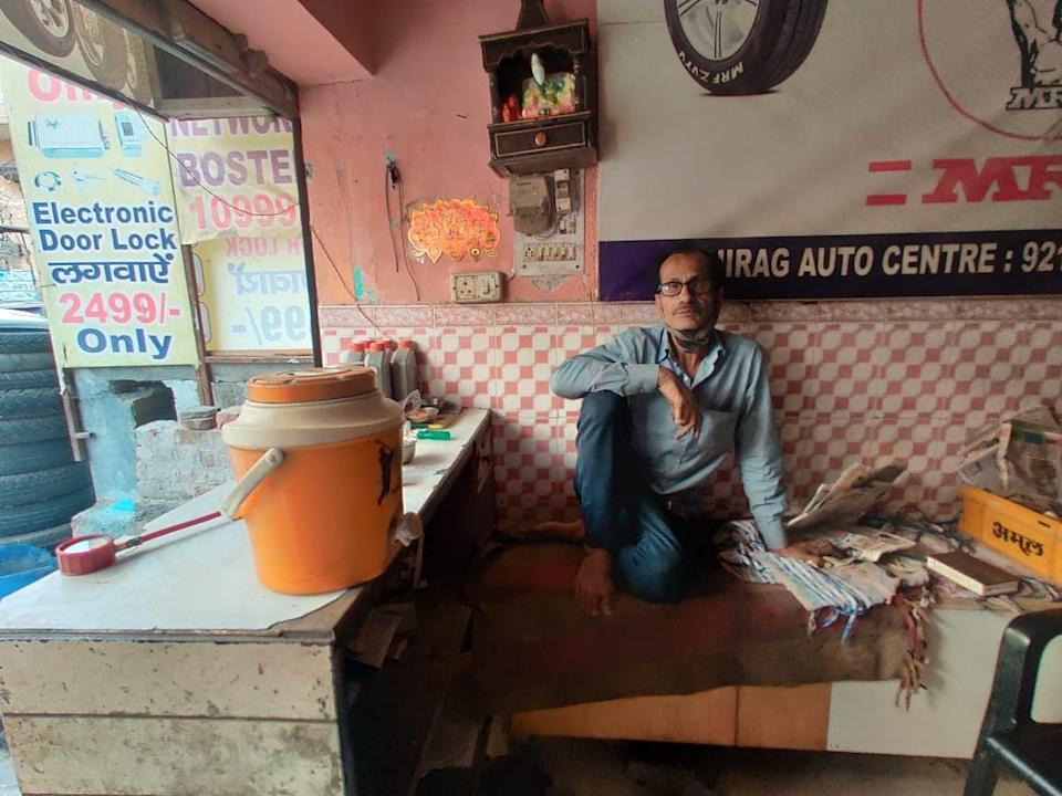 Gulshan Kumar pays Rs 6,000 rent for his one-room tire shop in Budh Vihar.